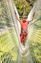 Boy on the net in adventure rope climbing park