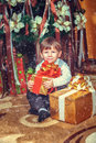 Boy with New Year's gifts Stock Photos