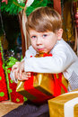 Boy with New Year's gifts Royalty Free Stock Photography