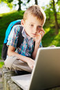 Boy with notebook in the park Royalty Free Stock Photos