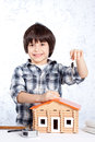 Boy offers the keys to a new home Stock Photos
