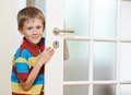 Boy opening door little smiling the white at home Stock Photo