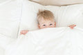 Boy out from under the blanket Royalty Free Stock Photo
