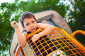 Boy in outdoors playground looking down from a toy house Royalty Free Stock Images