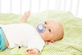 Boy with pacifier calm little month laying in his crib Royalty Free Stock Photos