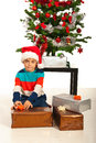 Boy packs christmas presents on white background Royalty Free Stock Photos