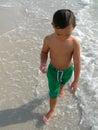 Boy paddling in sea Stock Photo