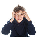 Boy in pain his hands are holding his head copy space at the top Royalty Free Stock Image