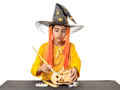 Boy painting pumpkin for halloween with big brush isolated on white Stock Images