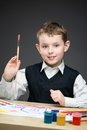 Boy painting something portrait of with paints and pencils concept of arts and hobby Royalty Free Stock Photography
