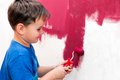 Boy painting the wall red Royalty Free Stock Photo