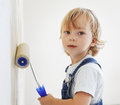 Boy paints the wall roller Stock Images