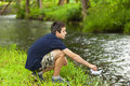 Boy with paper boat near the river in summer Royalty Free Stock Images