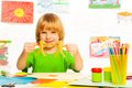 Boy with paper garland happy years old on preschool art lesson Royalty Free Stock Photos