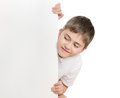 Boy peep out through poster white look on Stock Photography