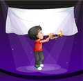 A boy performing at the stage with an empty banner Stock Photo
