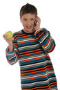 Boy on the phone holding an apple Stock Image