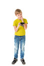 Boy with phone the looks to the on an isolated background Royalty Free Stock Images