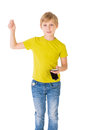 Boy with phone the looks to the on an isolated background Royalty Free Stock Photography