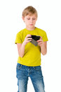 Boy with phone looks to the on an isolated background Royalty Free Stock Image