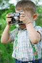 Boy photographer Stock Images