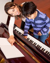 Boy in piano lessons Royalty Free Stock Photo