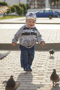 Boy and pigeons Royalty Free Stock Photo