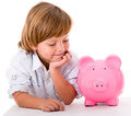 Boy with a piggybank happy savings in isolated over white background Royalty Free Stock Image