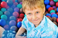 Boy in pile of balls Royalty Free Stock Photos