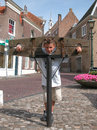 Boy in pillory Royalty Free Stock Photo