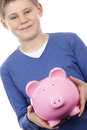 Boy with pink piggybank on white background Stock Images