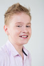 Boy in a pink shirt with growing molar teeth smiling instead of milk Royalty Free Stock Photos