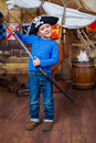 Boy pirate cute little wearing costume on the deck of a ship Royalty Free Stock Photography