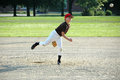 Boy pitching in youth baseball game Royalty Free Stock Photo
