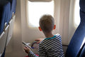 Boy in the plane little looking out window Royalty Free Stock Images
