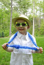 Boy with plastic glasses and lei a little wears sun blue hawaian Stock Photo