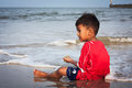 Boy play at the beach Royalty Free Stock Photo