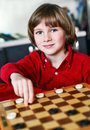 Boy play chess smilling little Royalty Free Stock Image