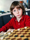 Boy play chess smilling little Stock Images