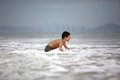 Boy play with ocean Royalty Free Stock Photo