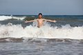 Boy play with ocean waves Royalty Free Stock Photo