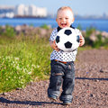 Boy play soccer little outdoor Stock Images
