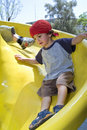 Boy on a playground slide Royalty Free Stock Image