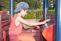 Boy at playground in wooden car Royalty Free Stock Image