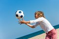 Boy playing with ball on beach close up action portrait of catching Royalty Free Stock Photos