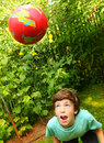 Boy playing with ball training soccer head blow Royalty Free Stock Photo