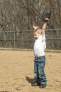Boy playing baseball young excited about catching a in his glove Royalty Free Stock Photo