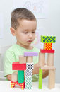 Boy playing with blocks in kindergarten Royalty Free Stock Photo