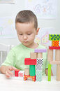 Boy playing with blocks in kindergarten Royalty Free Stock Photography