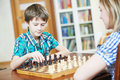 Boy playing chess at home Royalty Free Stock Photo